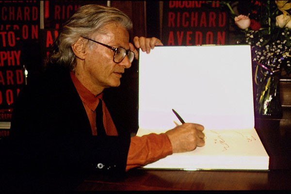 RICHARD AVEDON SIGNING HIS AUTOBIOGRAPHY